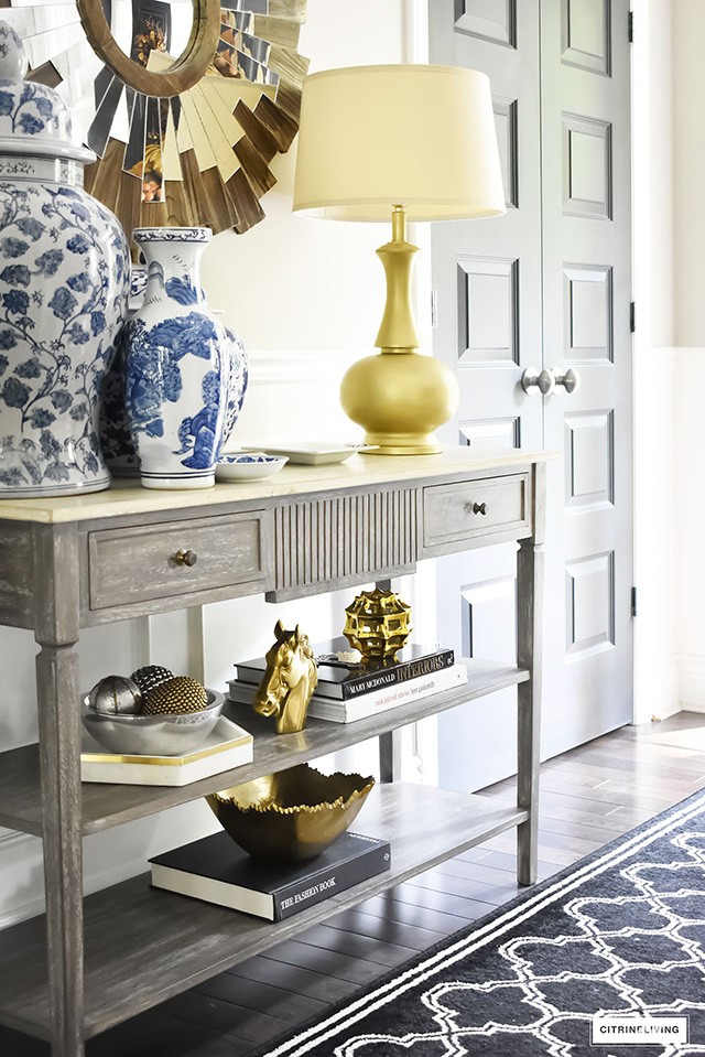 Console table styled with gold accessories