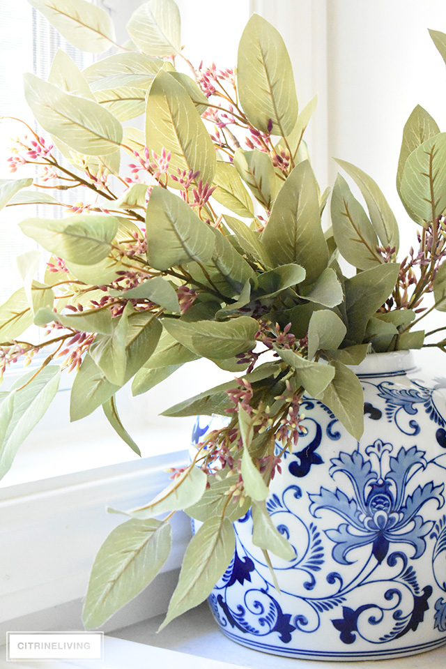 Fall kitchen decorating with blue and white ginger jar with faux greenery.