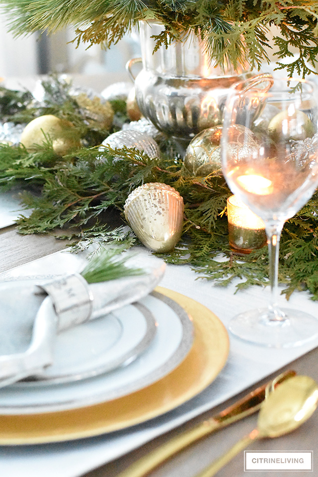 Create a stunning Christmas table with fresh greenery and ornaments in just a few minutes!
