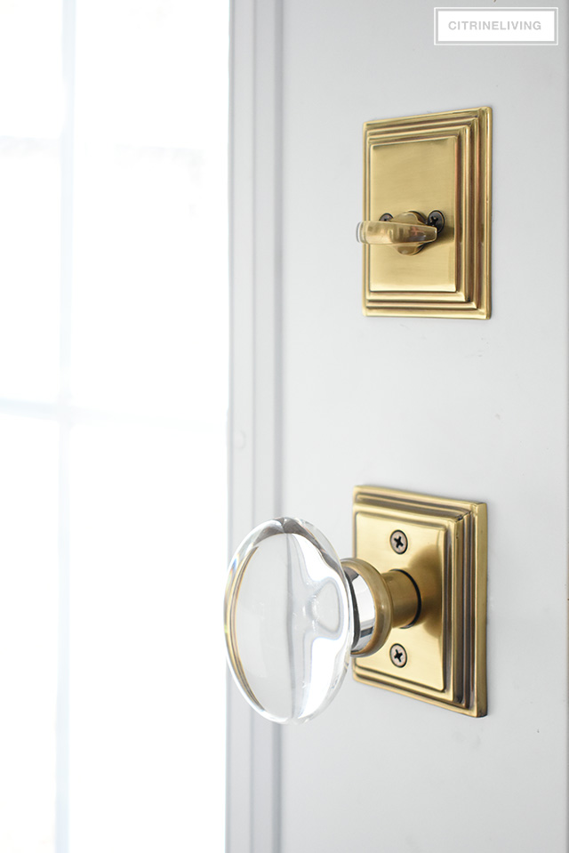 Gorgeous French Antique brass hardware from Emtek featuring Hampton glass knob, and Wilshire rosette and deadbolt.