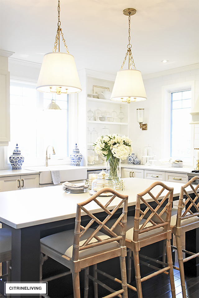 Kitchen pendant lighting with shades and Chinese Chippendale barstools are an elegant and sophisticated look in this kitchen.