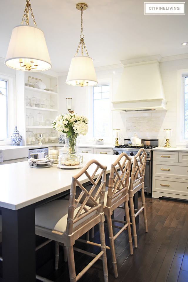 w kitchen lighting and barstools + a vintage style rug add character and tailored elegance to our kitchen, it's a chic and sophisticated mix!