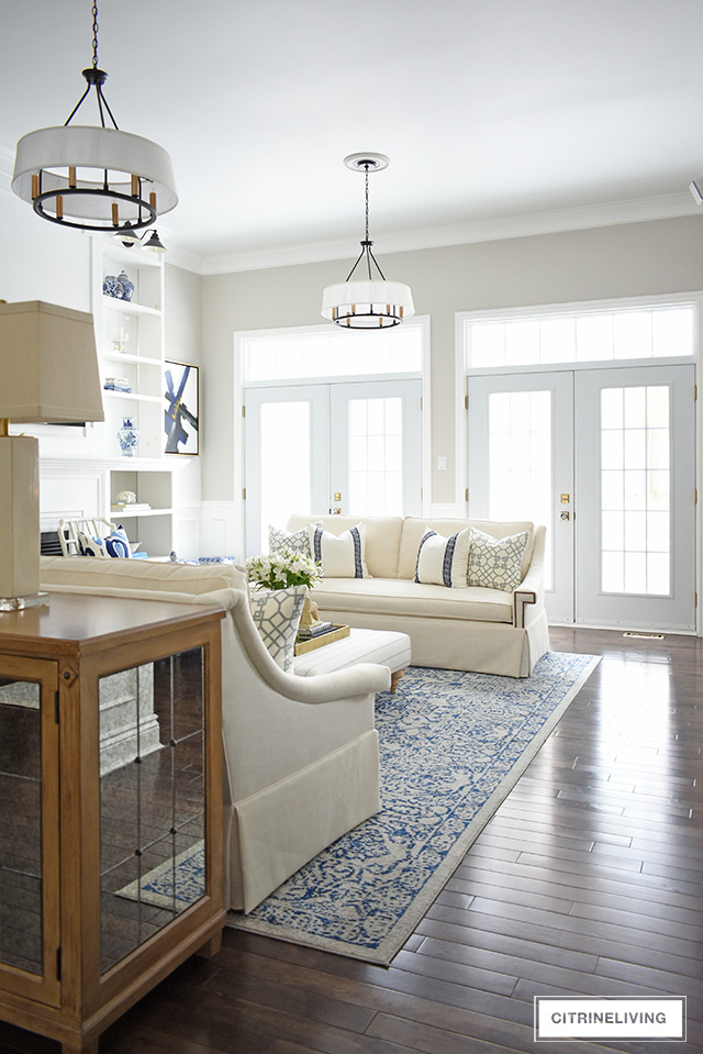 Gorgeous new white sofas completely transform this living room into a bright, airy and sophisticated space!