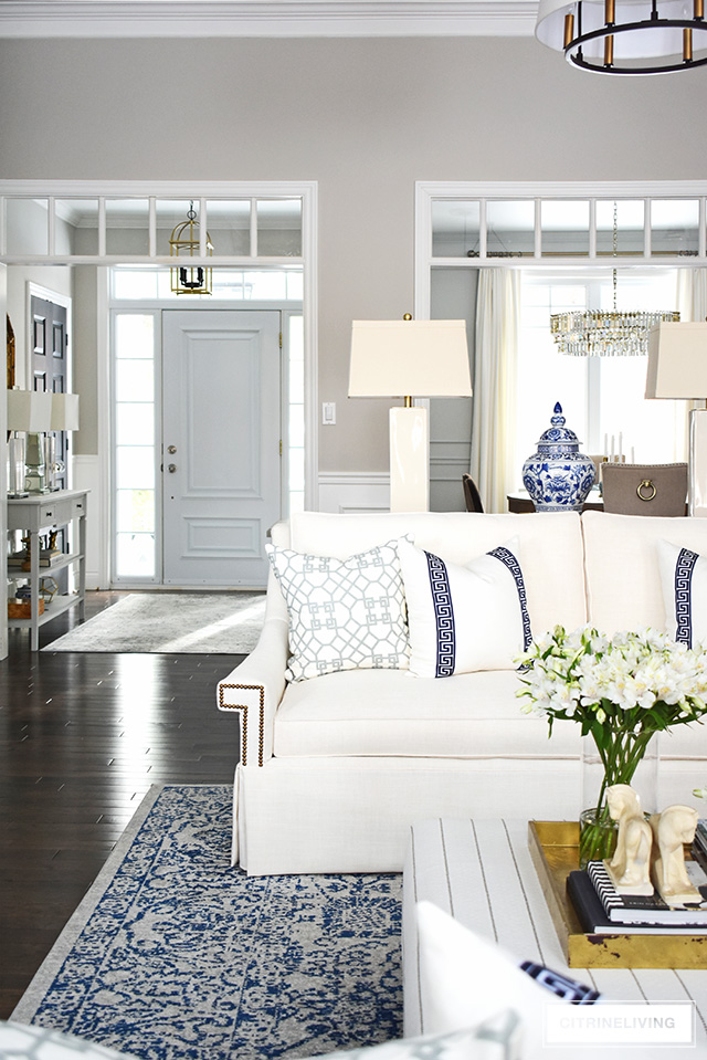 New white sofas completely transform this open concept living room to an airy, sophisticated space.