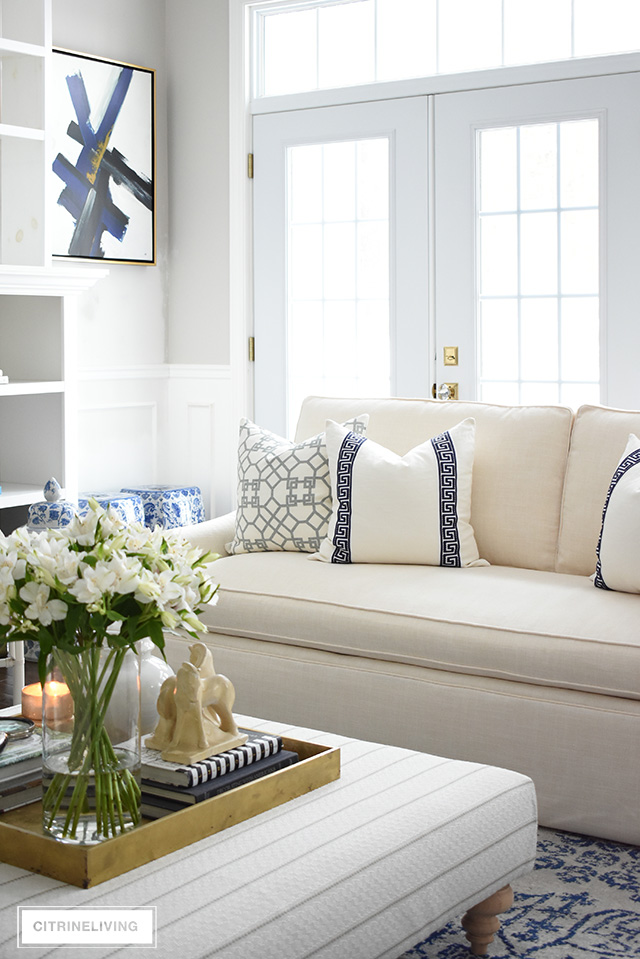Gorgeous designer pillows featuring greek key and lattice print help to create a refined and elegant look in this stunning living room makeover.