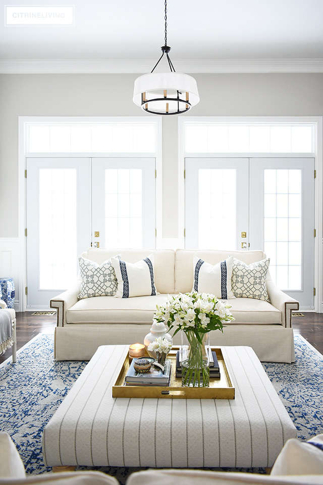 Gorgeous new white sofas with stunning details - brass nailhead trim, a sophisticated skirt, curved arms and bench cushion - these elegant and refined sofas elevate this living room to another level!