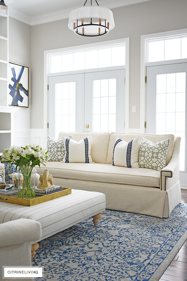 Our new white sofas have completely transformed our living room! Gorgeous designer pillows featuring greek key and lattice print help to create a refined and elegant look in this stunning living room makeover.