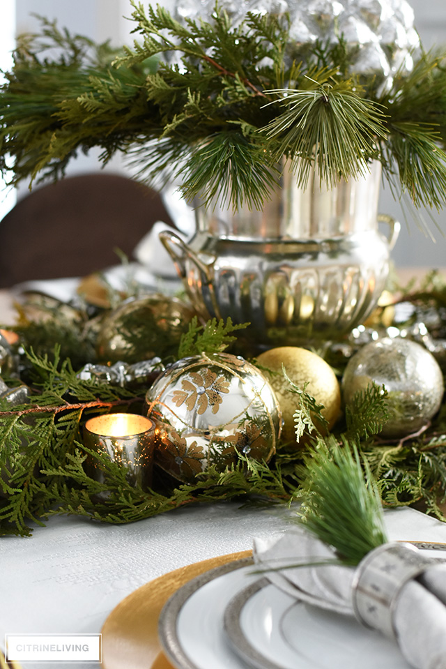 This beautiful Christmas table with fresh greenery and ornaments is so simple to create and is perfect for the holidays