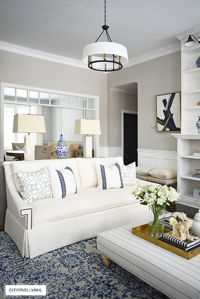 Stunning living room makeover with elegant white sofas - this space is sophisticated and refined yet still casual and welcoming!