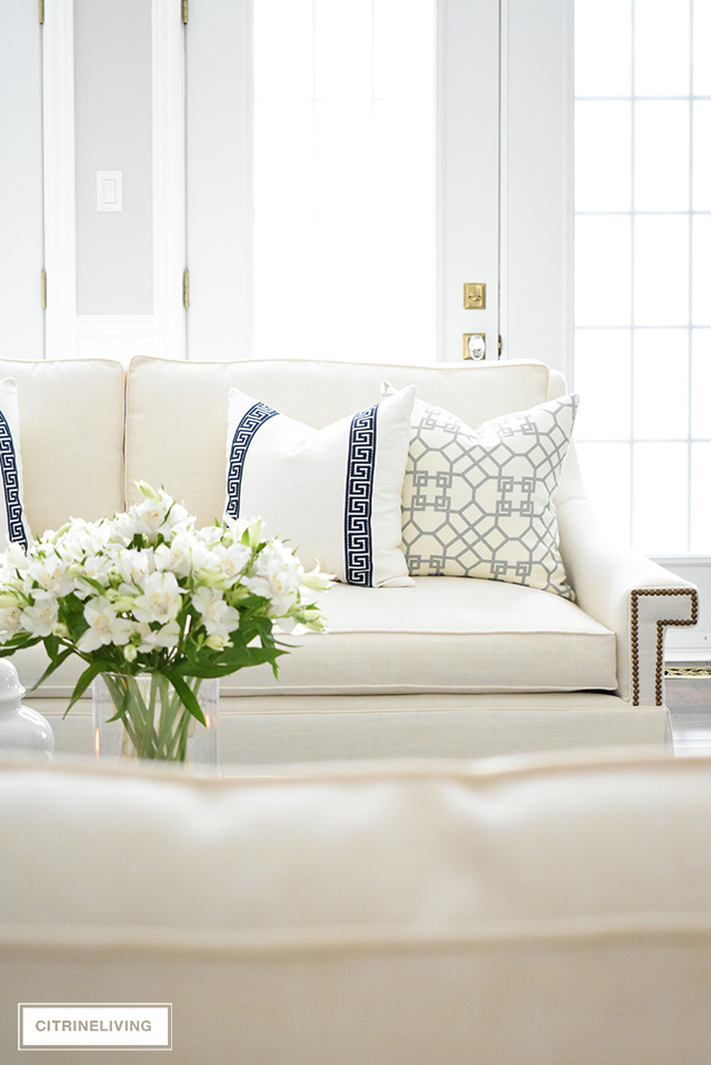 These gorgeous white sofas have completely transformed this living room to a bright, airy and sophisticated space!