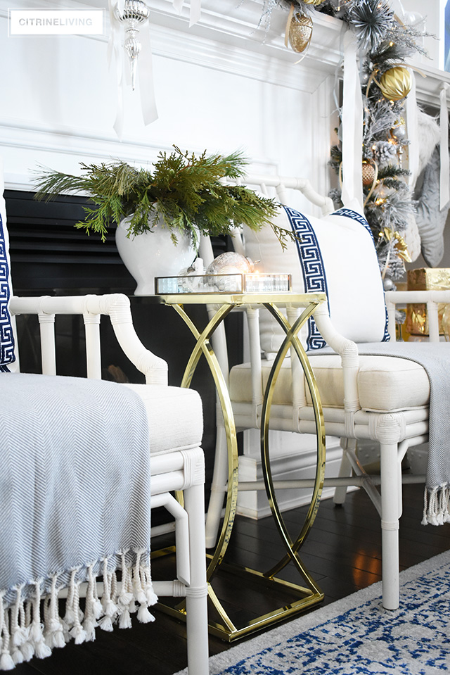 Create glamour and sophistiation in your Christmas living room this holiday with affordable and gorgeous decor like this fabulous brass accent table!