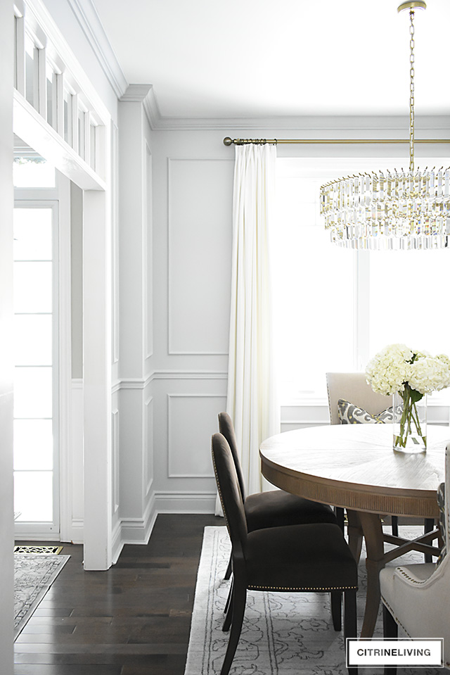 A gorgeous dining room makeover reveal with new gray walls and moldings, painted from the crown to the basboards for a chic, sophisticated, bright and airy look.
