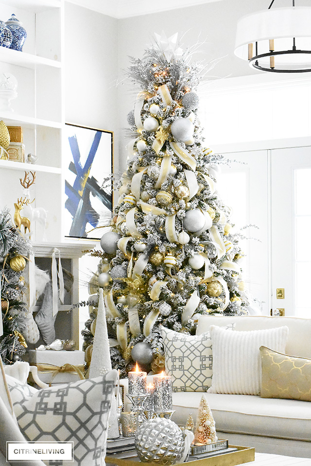 Gorgeous flocked Christmas tree + garland, dressed in magical silver and gold!
