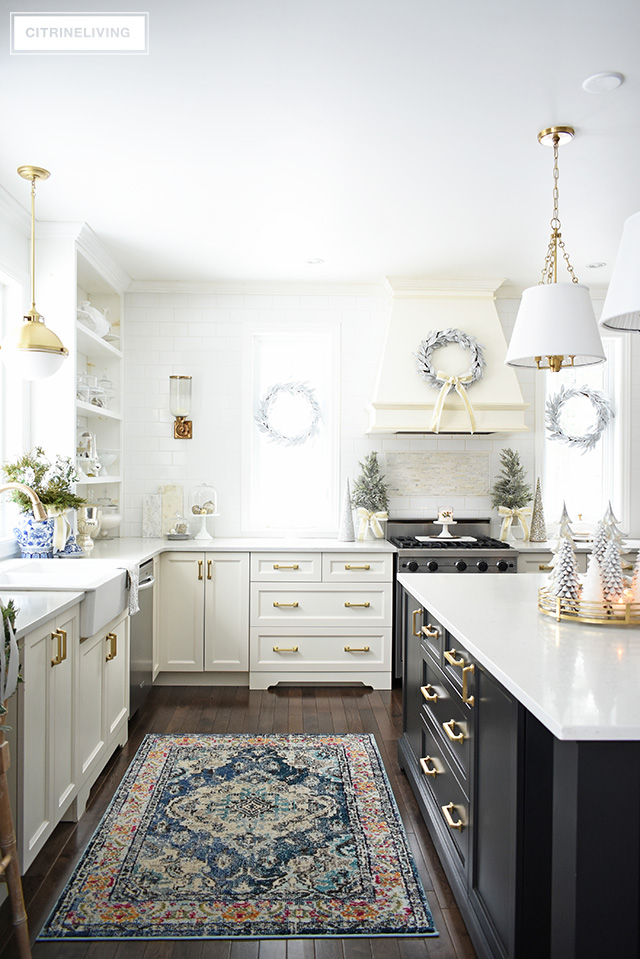 Christmas kitchen decorating using silver and gold mixed with touches of holiday greenery is the perfect