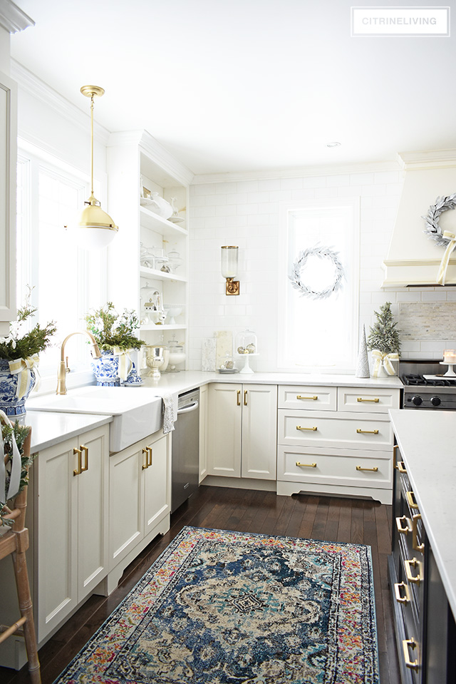 Christmas kitchen decorating using silver and gold mixed with touches of holiday greenery is the perfect mix of elegant and chic.