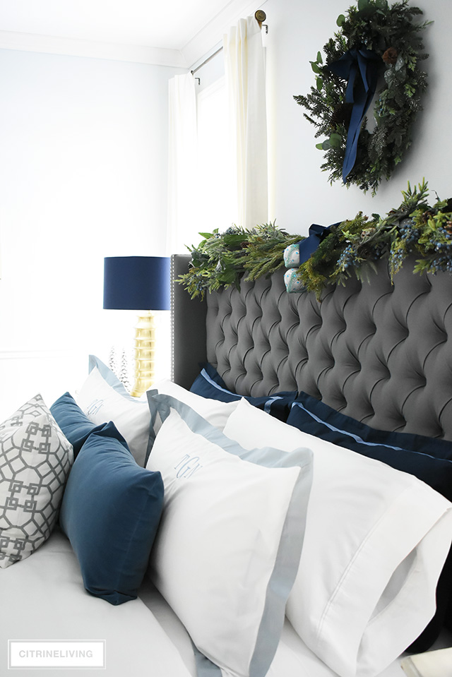 Create a gorgeous, luxurious Christmas bedroom you'll never want to leave with beautiful bedding and festive holiday greenery!
