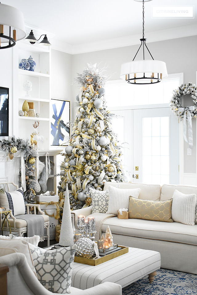 Create a stunning Christmas decorated living room with silver and gold accents for a sophisticated and glamorous space.