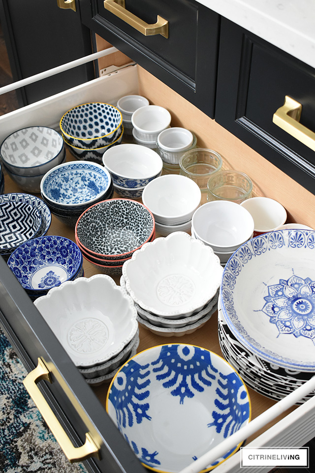 Organized kitchen drawers, bowl and plates
