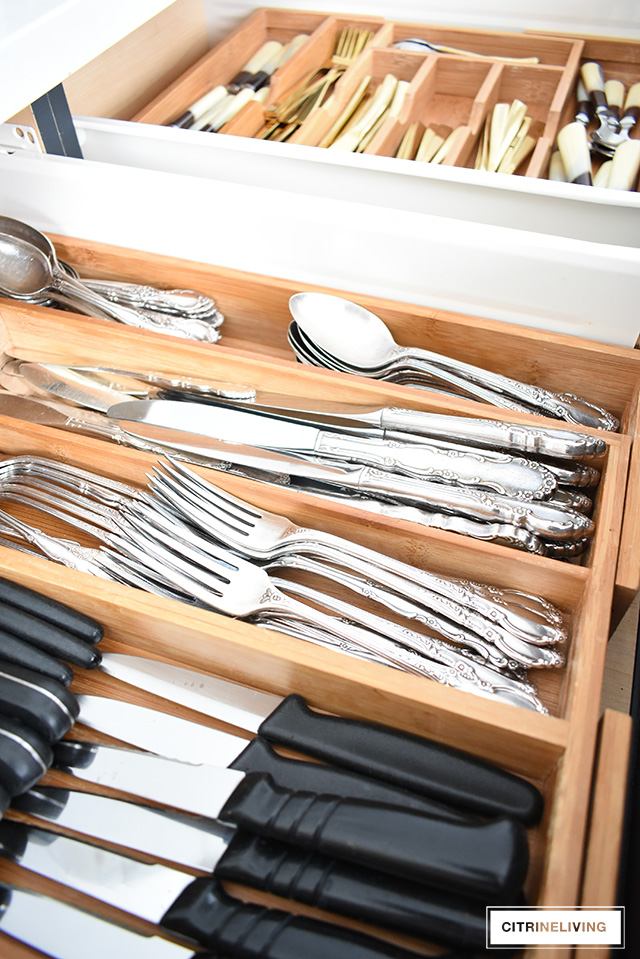 Organized kitchen drawers spoon and fork