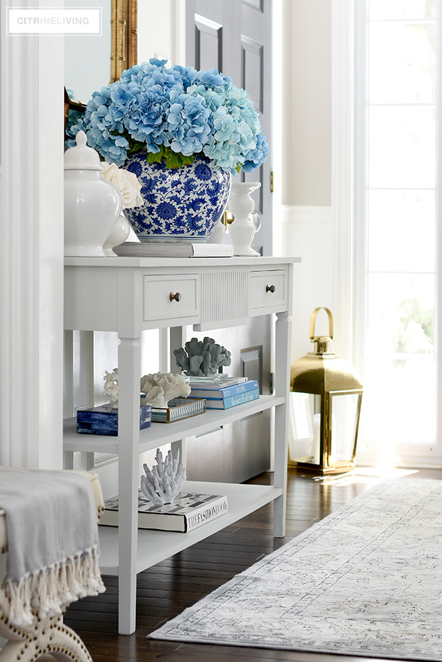 A gorgeous Spring entryway with blue, white and brass touches creates a fresh and vibrant welcome.
