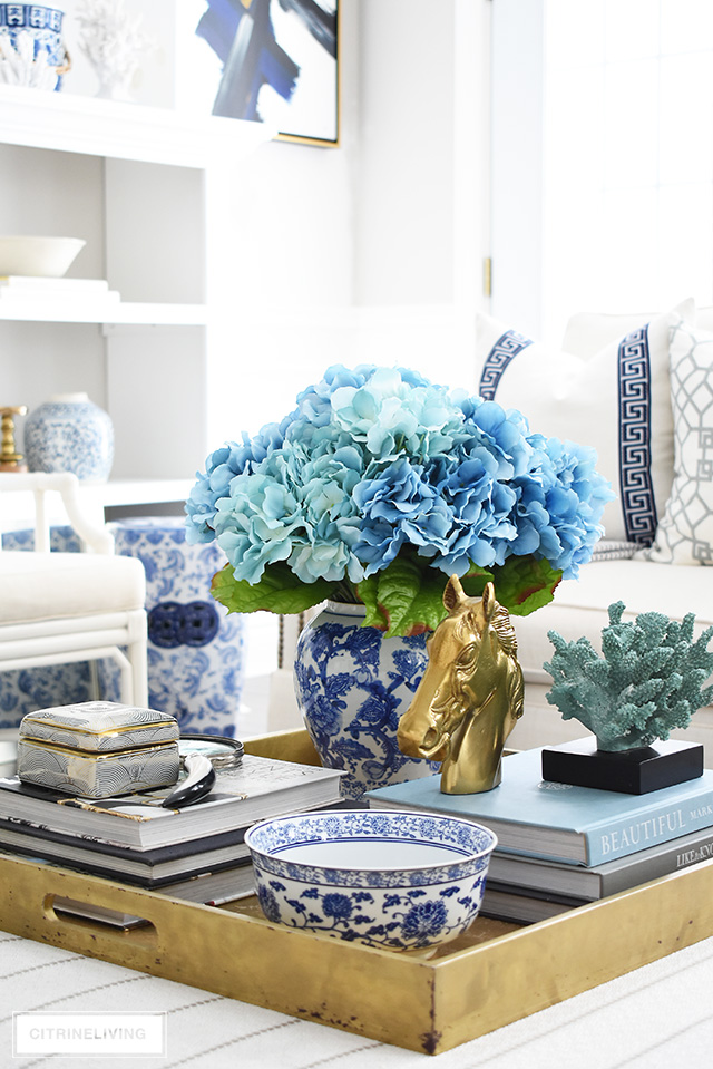 Try these coffee table decorating ideas + styling tips to always create a beautiul display on your table or ottoman, any time of year!