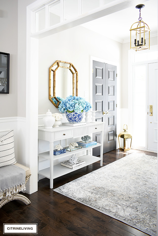 Create stunning spring entryway with a large-scale faux floral arrangement to make a bold statement.