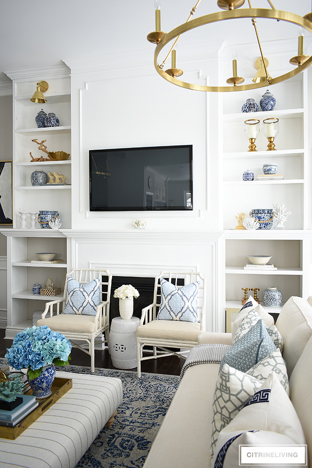 How to decorate bookshelves for spring citrineliving - How to decorate room ...