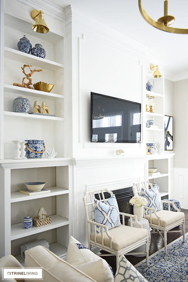 Styling shelves can be tricky! I'm sharing how to decorate bookshelves with simple ideas that you can use to create a gorgeous spring-styled space!