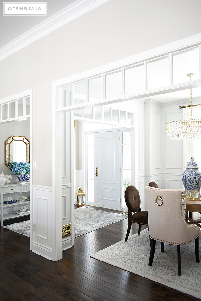 Open concept home with transom detailing. Spring decorating ideas with blue and white, faux florals.