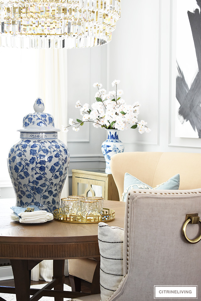 Spring decorating ideas using blue and white jars and vases and faux cherry blossoms.