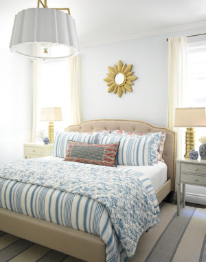 Beautiful Beautiful summer decorated bedroom with blue and white striped bedding , upholstered bed with brass nailhead trim is chic and elegant. decorated bedroom with blue and white striped bedding , upholstered bed with brass nailhead trim