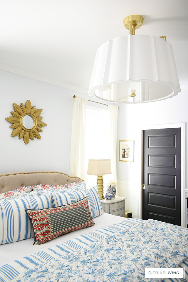 Bedroom refresh featuring a dramatic over-scale drum shade chandelier with elegant detailing and brass accents.