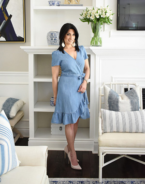Summer decorating and fashion ideas, denim wrap ruffled dress with boho earrings and classic light beige stiletto pump.