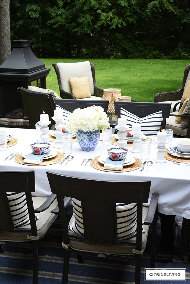 Late summer tablescape with blue and white dishes and fresh hydrangeas.