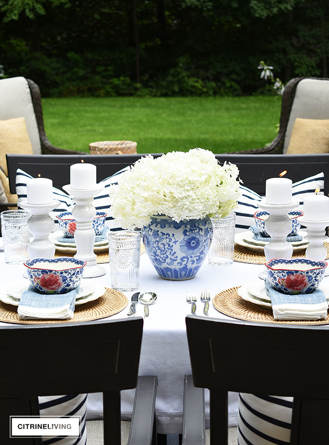 Late summer tablescape with blue and white ginger jar with fresh hydrangeas and vintage-inspired dishes