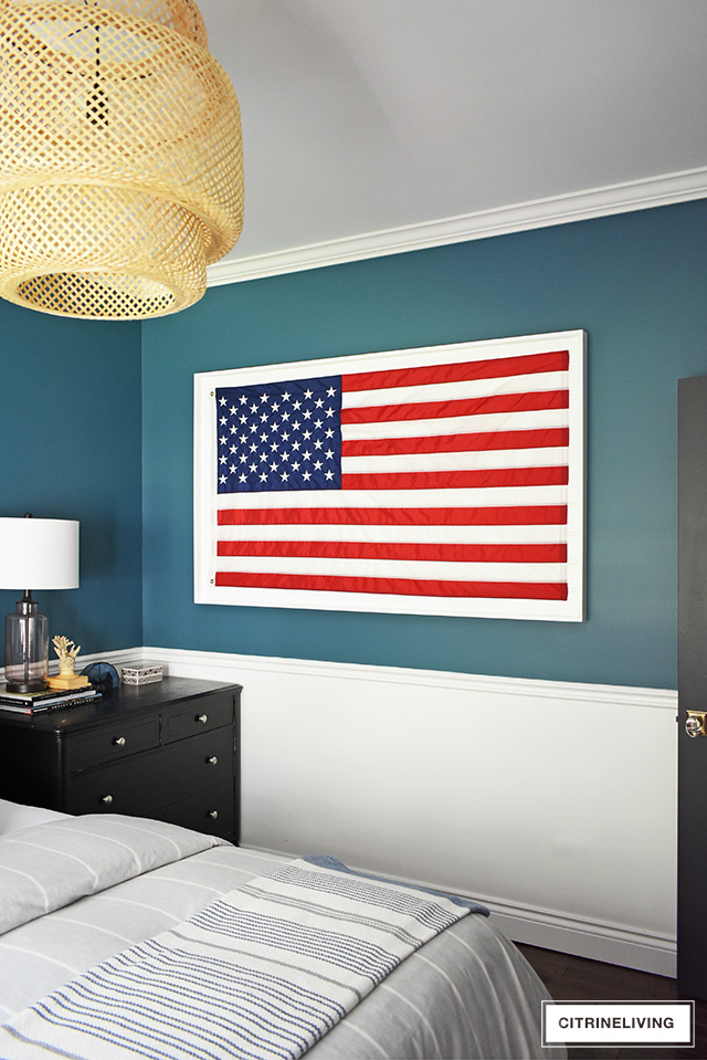 Modern coastal teen bedroom with American flag in white shadow box.