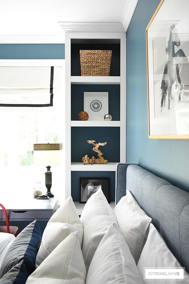 Modern coastal teen bedroom - open shelves with modern accessories - woven baskets., wood frames, modern art and objects.
