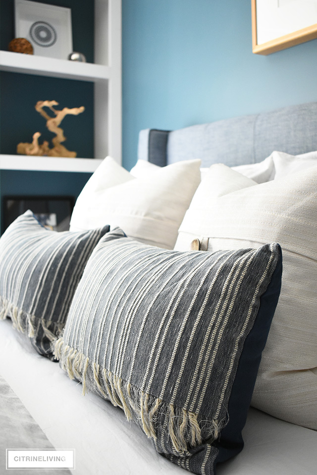 Modern coastal teen bedroom - striped and textured throw pillows layered for a luxe, relaxing look