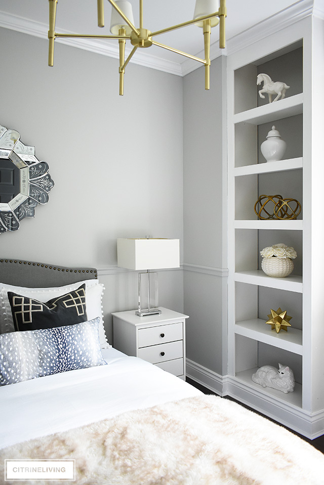 Beautifully styled bookshelves in this glam teen girl bedroom, using white and brass for an elegant and chic look!