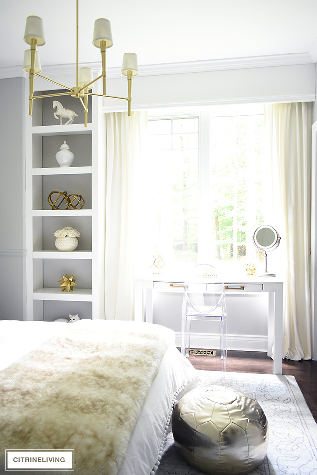 A chic and sophisticated teen girl bedroom layered with creams, ivories, grey and brass. A modern and elegant brass chandelier complete the look!