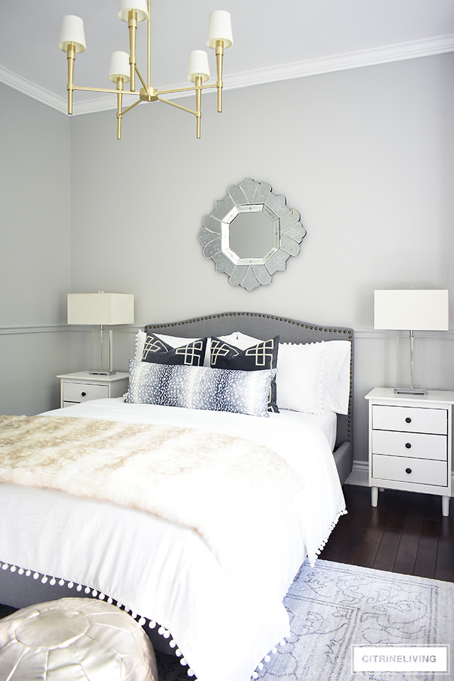 This stunning teen girl bedroom makeover is perfectly styled with neutral layers of white and grey with brass accents throughout. Crystal lamps and a brass chandelier are a chic and elegant addition!
