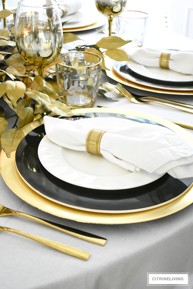 Beautiful fall luxe tablescape with a gold, black and white palette for an elegant and sophisticated take on the season.