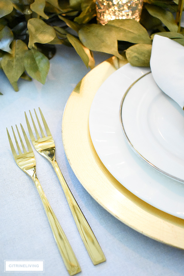 Beautiful luxe fall tablescape with gold charger plates, flatware and elegant white dishes is simple and classic.