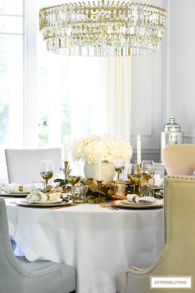 Beautiful fall luxe tablescape with faux hydrangeas and gold leaf picks for an easy and elegant centrepiece.