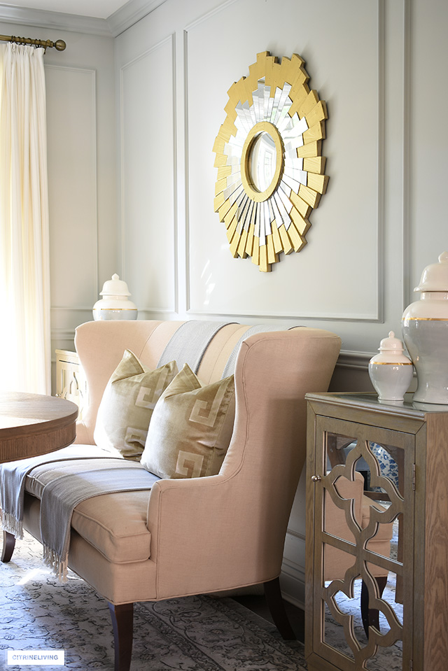 Chic + elegant dining room decor - use settee with luxe velvet pillows to welcome guests.