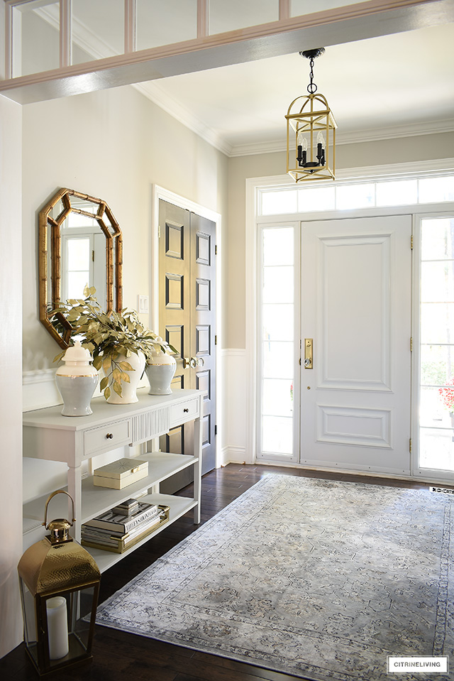 Elegant fall entryway - console table styled with ginger jars, faux leaves, and simple accessories for a clean + sophisticated look.
