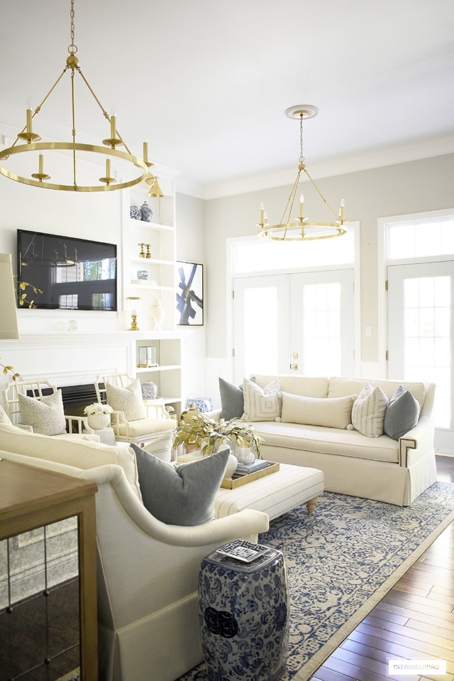 Elegant Fall living room with warm neutrals, soft textures and muted colors are perfectly paired with gold autumn accents.