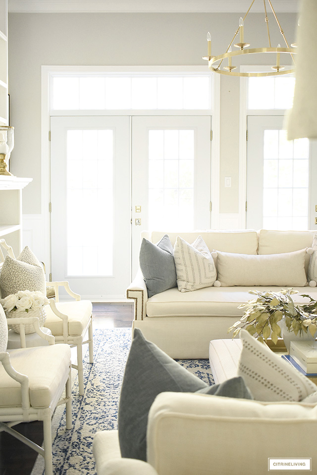Casual and elegant fall living room with warm neutrals, muted colors and soft gold touches, is laid-back but still sophisticated and tailored.