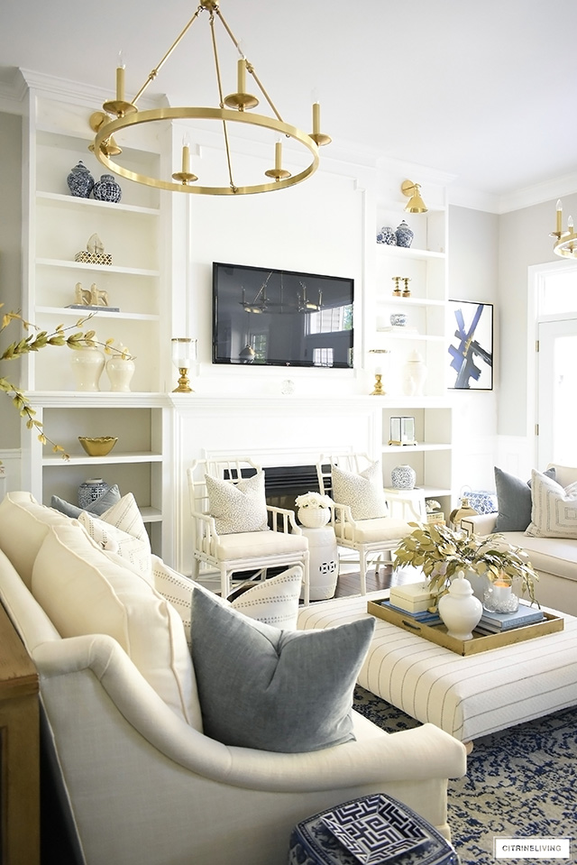 Beautiful and elegant fall living room with warm neutrals, muted colors and gold autumn accents is warm and welcoming for the season.