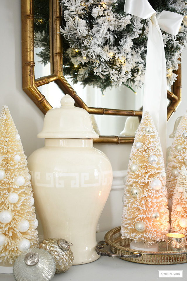 Classic ginger jars and bottle brush trees are the perfect way to create an elegant and welcoming Christmas entryway.